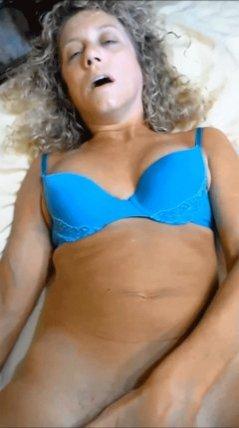 Curly blonde slut fingering pussy